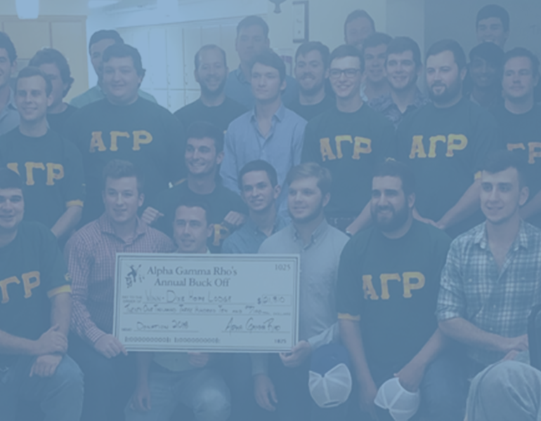 Blue filter over photo of several young men posing with a large fundraising check.