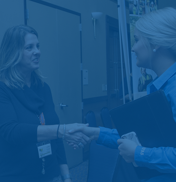 Female CALS student shaking hands with an employer